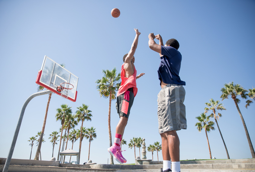 Two basketball players playing outdoor in LA