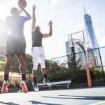 Two afroamerican athlethes playing basketball outdoors - Basketball athlete training on court in New York