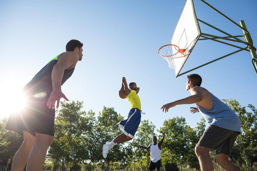 Basketball player making slam dunk in Madrid, Spain